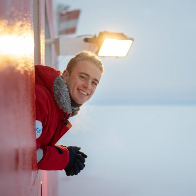 Picture of Sam Cornish looking out over sea ice from research vessel Akademik Fedorov